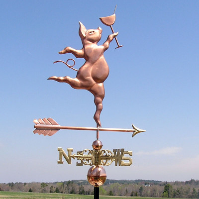 Party Pig Weathervane right side view on blue sky background.