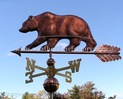 Bear Weathervane left side view on blue sky background