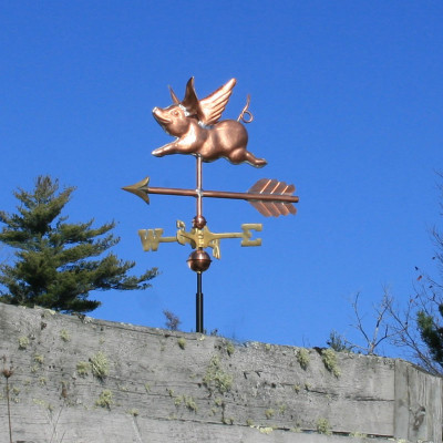 Small Flying Pig Weathervane left side view on blue sky background