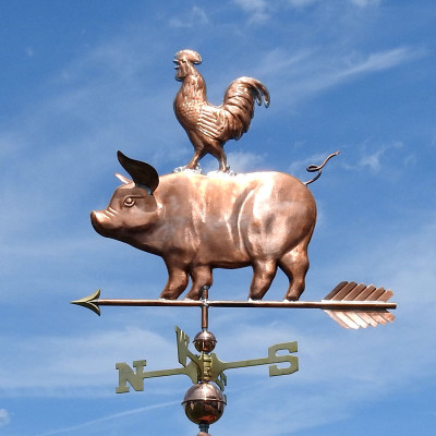 Pig and Rooster Weathervane left side view on blue sky background