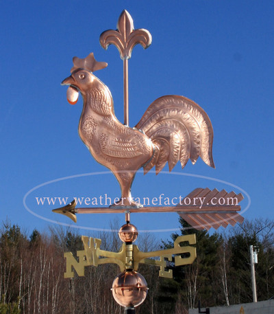 Rooster Weathervane with Fleur de lis left side view on blue sky background