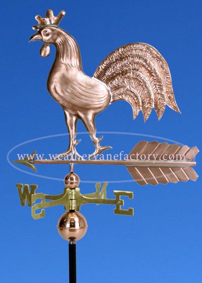 Walking Rooster Weathervane left side view on blue sky background