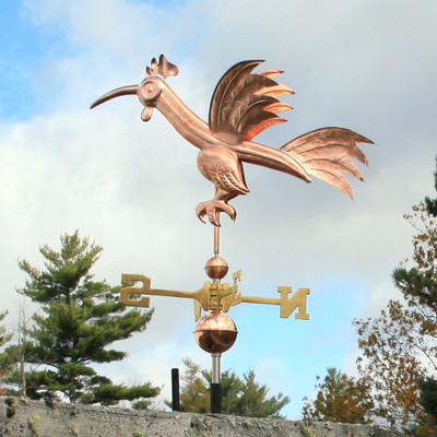 Fun Rooster Weathervane Left Side View on Blue and Cloudy Sky Background