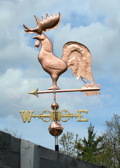 Maine Rooster Weathervane left side view on stormy background
