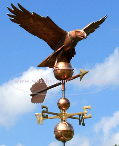 American Eagle Weathervane front view on blue and cloudy sky background