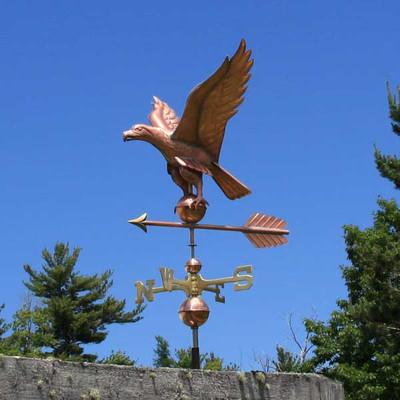eagle weathervane left angle view on blue sky background