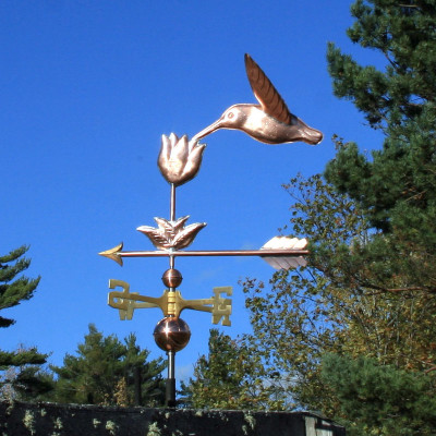 Hummingbird with Flower Weathervane shown left side view on blue sky background.