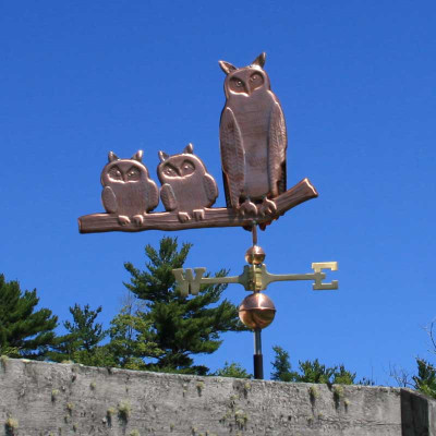 Three Owls Weathervane right side view on blue sky background