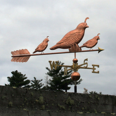 three quail weathervane right side view on stormy background