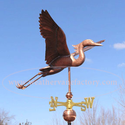 Large Heron Weathervane right side view on blue sky background