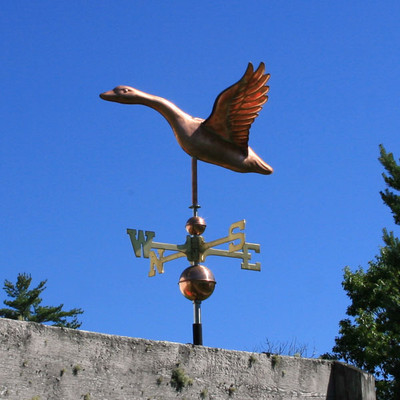 Flying Goose Weathervane left side view on blue sky background