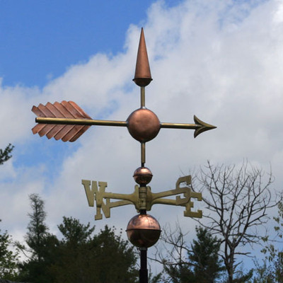 center arrow weathervane right side view on cloudy background