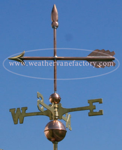 Simple Arrow Weathervane left side view on blue sky background