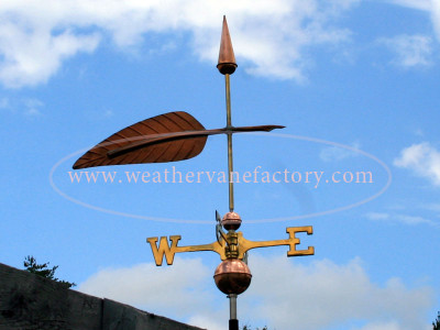feather/ quill weathervane right side view on blue sky background