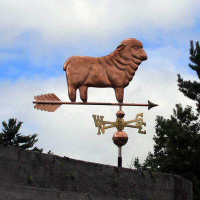 Sheep Weathervane right side view on blue and cloudy background