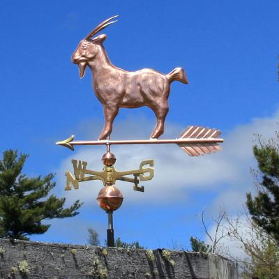 Goat Weathervane left side view on blue sky background