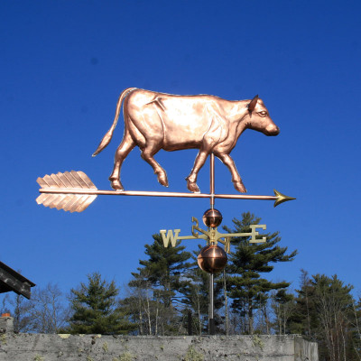 Large Cow Weathervane right side view on blue sky background