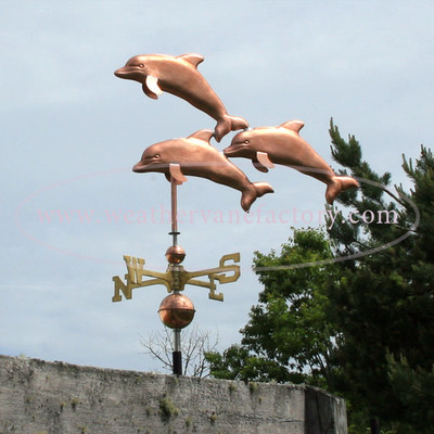 Three Dolphins Weathervane left side view on gray sky background