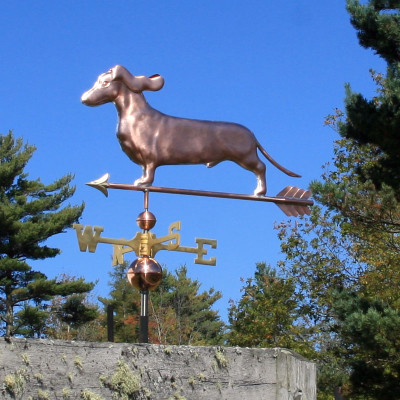 Dachshund Weathervane with ears flowing left front angle on blue sky background