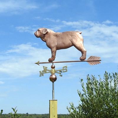 copper bulldog weathervane left side view on blue sky background