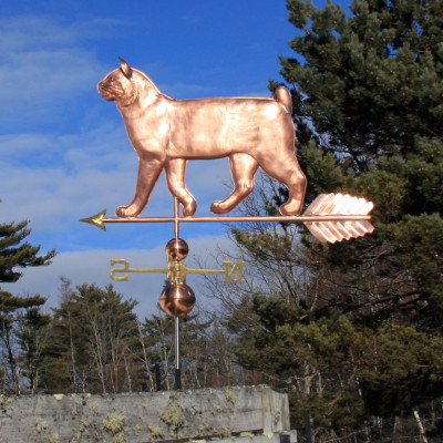 large walking bobtail cat weathervane left side view on blue cloudy background