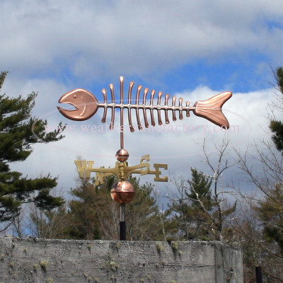 copper bonefish weathervane left side view on cloudy background