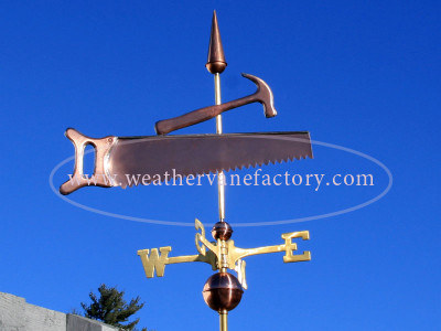 saw and hammer weathervane right side view on blue sky background
