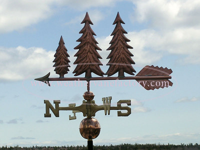 Three Pine Tree Weathervane left side view on cloudy sky background