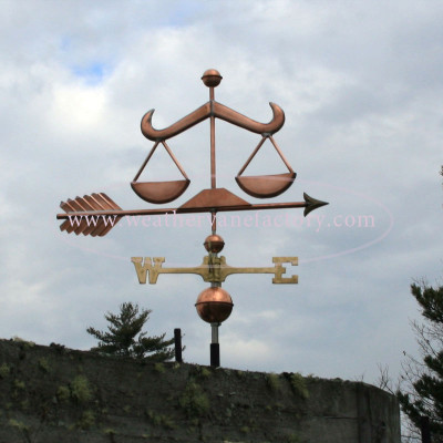 Scales of Justice Weathervane right side view with cloudy sky background