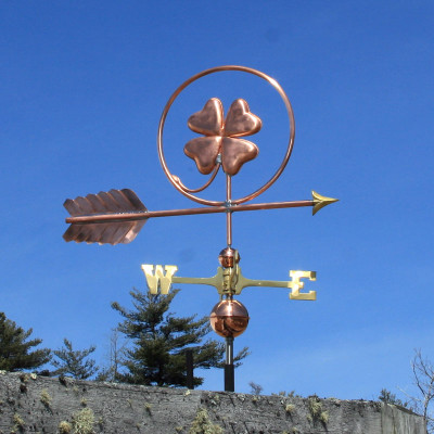 Four leaf clover Weathervane right side view on blue sky background.