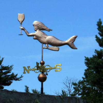 Mermaid with Wine Glass Weathervane left side view on blue sky background