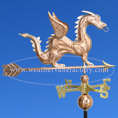 dragon weathervane right side view on blue sky background