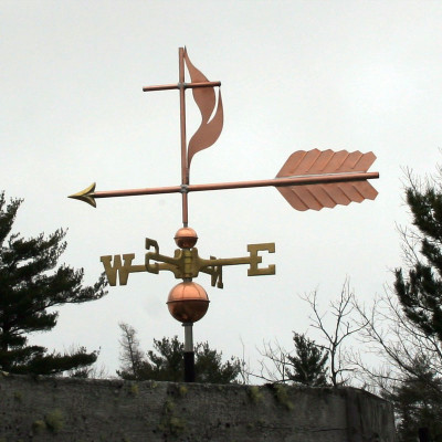 Methodist Cross and Flame Weathervane Left Side View on gray sky background