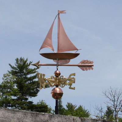 Sailboat Weathervane and left front side view cloudy sky background