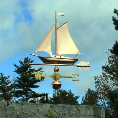 Sailboat Weathervane left side view on cloudy background