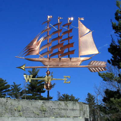 Large Clipper Sailboat Weathervane left side view on blue sky background