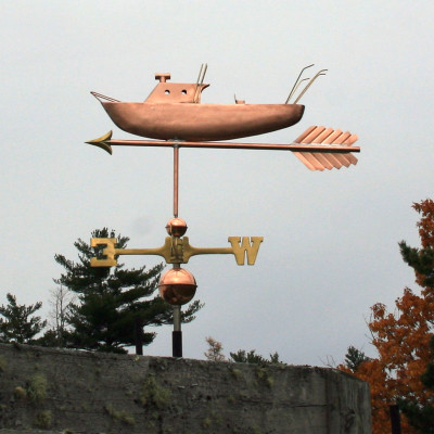 Fishing Boat Weathervane left side view on cloudy sky background