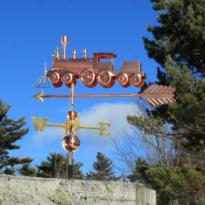 Train Weathervane Left Side View on Blue Sky Background.