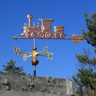 Train Weathervane left side view on blue sky background
