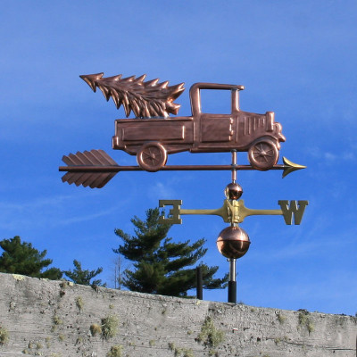 Pickup Truck with Christmas Tree Weathervane right side view on blue sky background