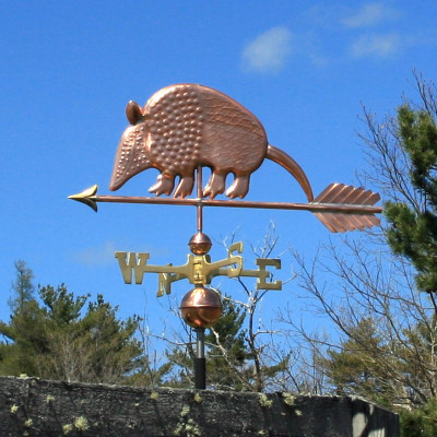 Armadillo Weathervane left side view on blue sky background