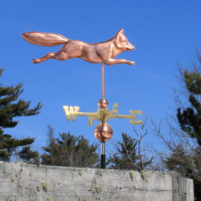 Fox Weathervane on blue sky background