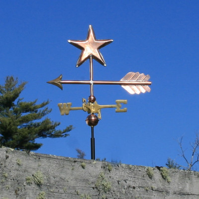 Star Weathervane side view on blue sky background