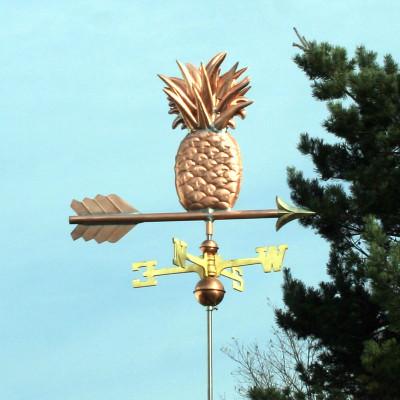 Pineapple Weathervane slight right side view on light blue sky background.
