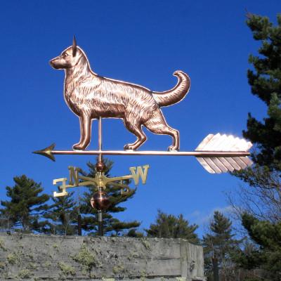 Large German Shepherd Weathervane left side view on bright blue sky background.