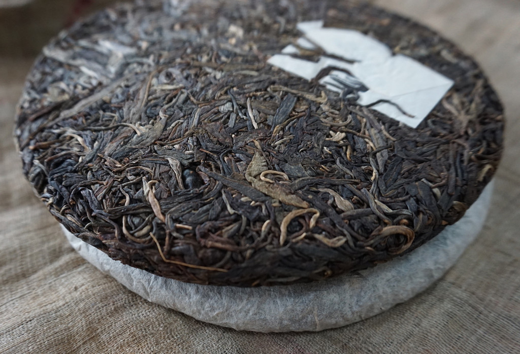 Man Nuo Ancient Tree Raw Puer 2009 unwrapped