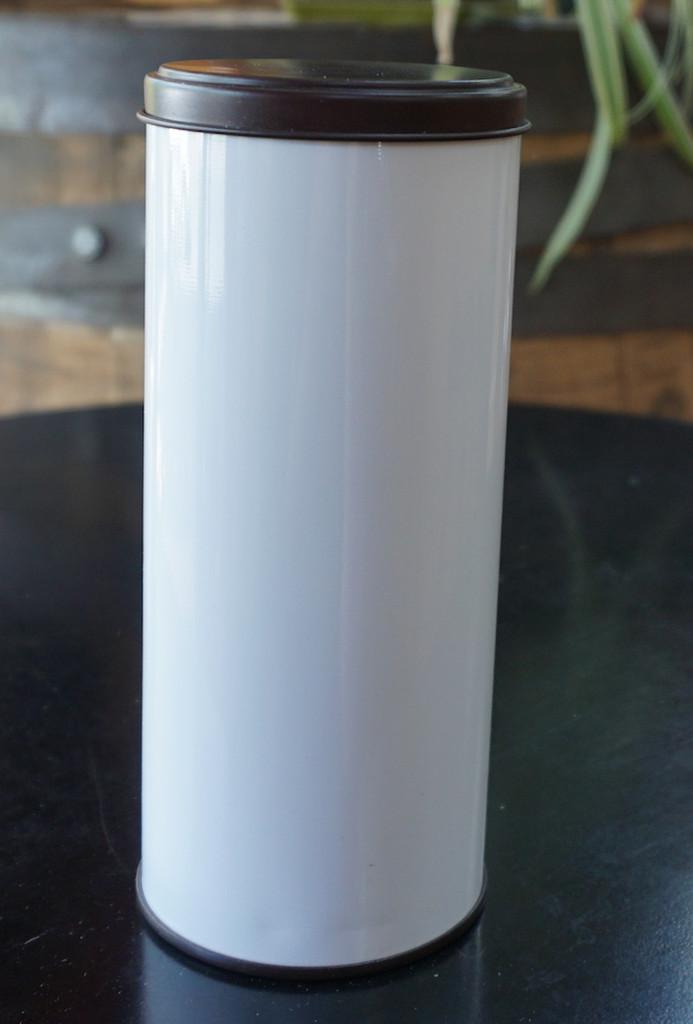 tea tin black and white holds 1/4lb. loose leaf tea