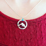 Sterling Silver Dolphin Circle of Life Blue Topaz Necklace