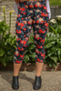 Vibrant Roses Floral Printed Butter Soft Cropped Leggings front view.