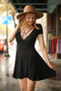 Flirty and Flawless Black Fit and Flare Wrap Dress front view.
